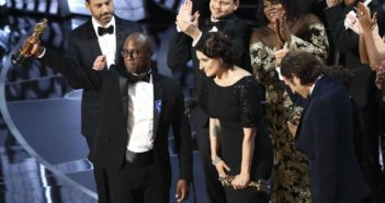 "Barry Jenkins and the cast and crew of ""Moonlight"" celebrate after winning the Oscar"