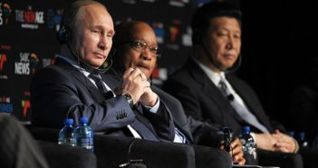 Russian President Vladimir Putin (left) with his South African counterpart Jacob Zuma and Chinese President Xi Jinping (right) at the 5th BRICS Summit on 27 March 2013 in Durban, South Africa