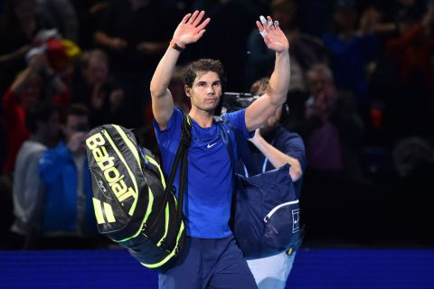 Rafael Nadal waves to the crowd after losing his singles match against Belgium's David Goffin on day two of the ATP World Tour Finals tennis tournament at the O2 Arena in London on November 13, 2017. AFP PHOTO